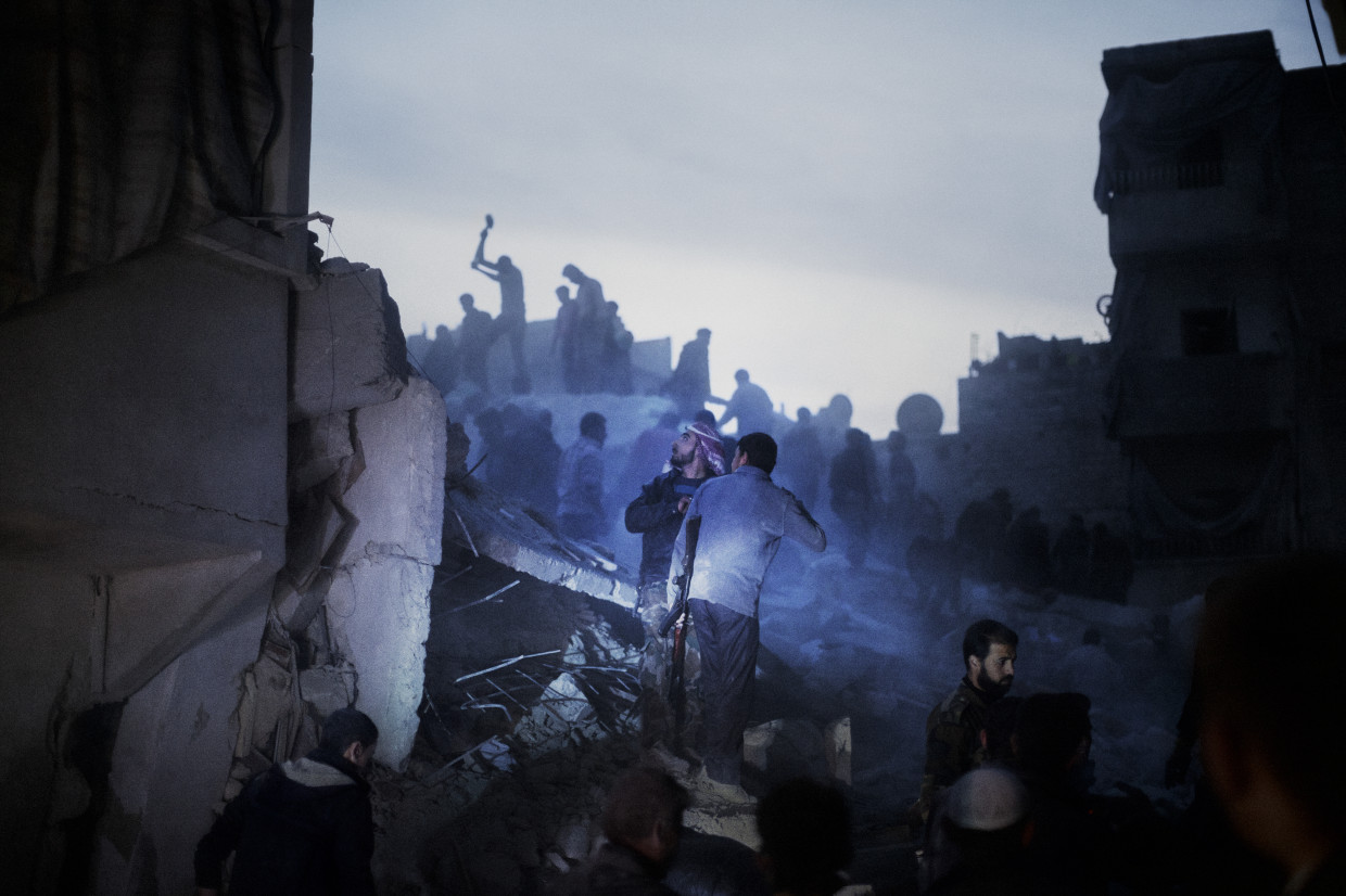 Aleppo, Syria. March, 2013. Searching for survivors in the aftermath of bombardment by regime warplanes in a rebel-held residential district in Aleppo.