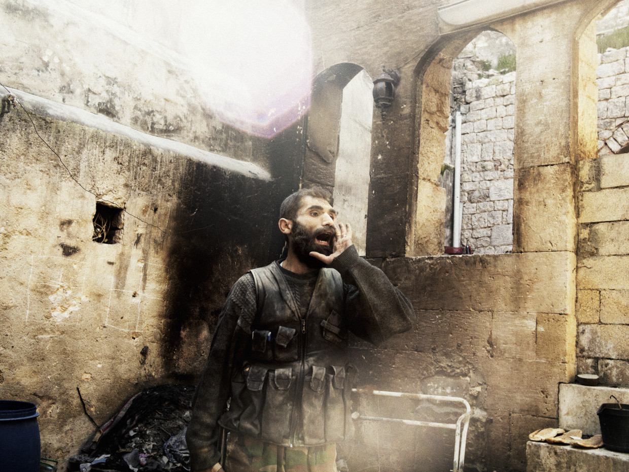 "Aleppo, Syria. March, 2013. A rebel yells ""Allahu Akbar"" (God is Great) during close-quarters fighting in Aleppo's Old City."