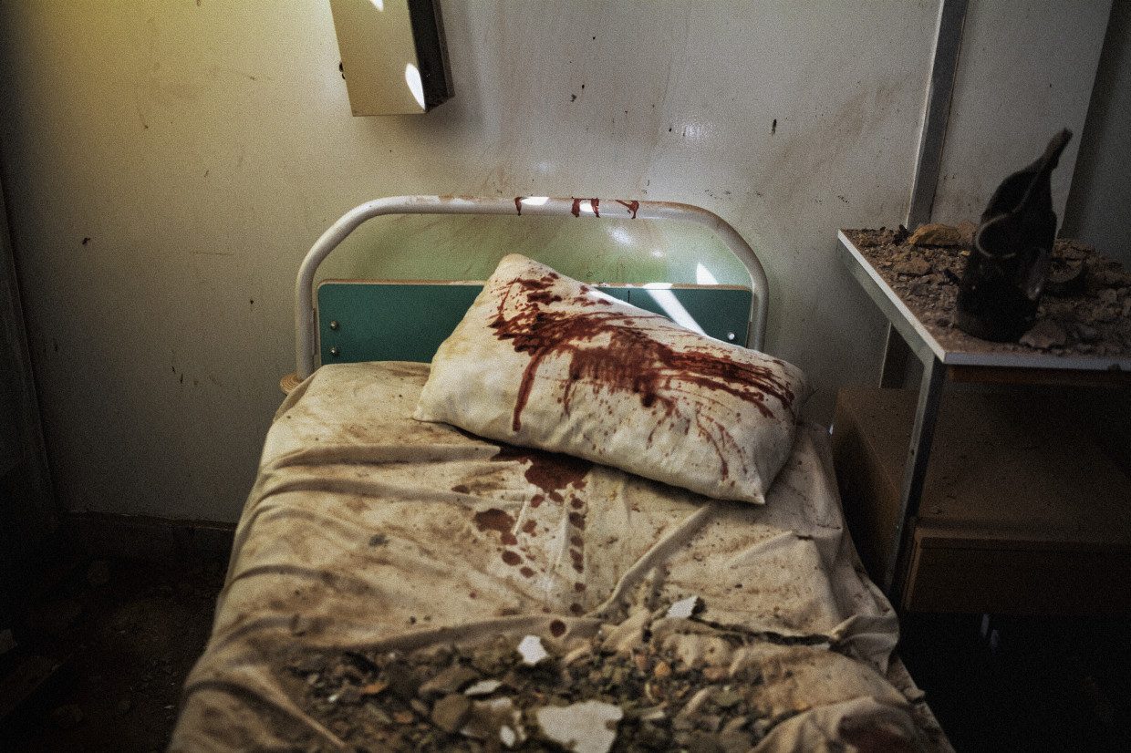 Zlitan, Libya. March, 2011. Fake blood spilled in a hospital bed at the site of an alleged NATO airstrike in the city of Zlitan.