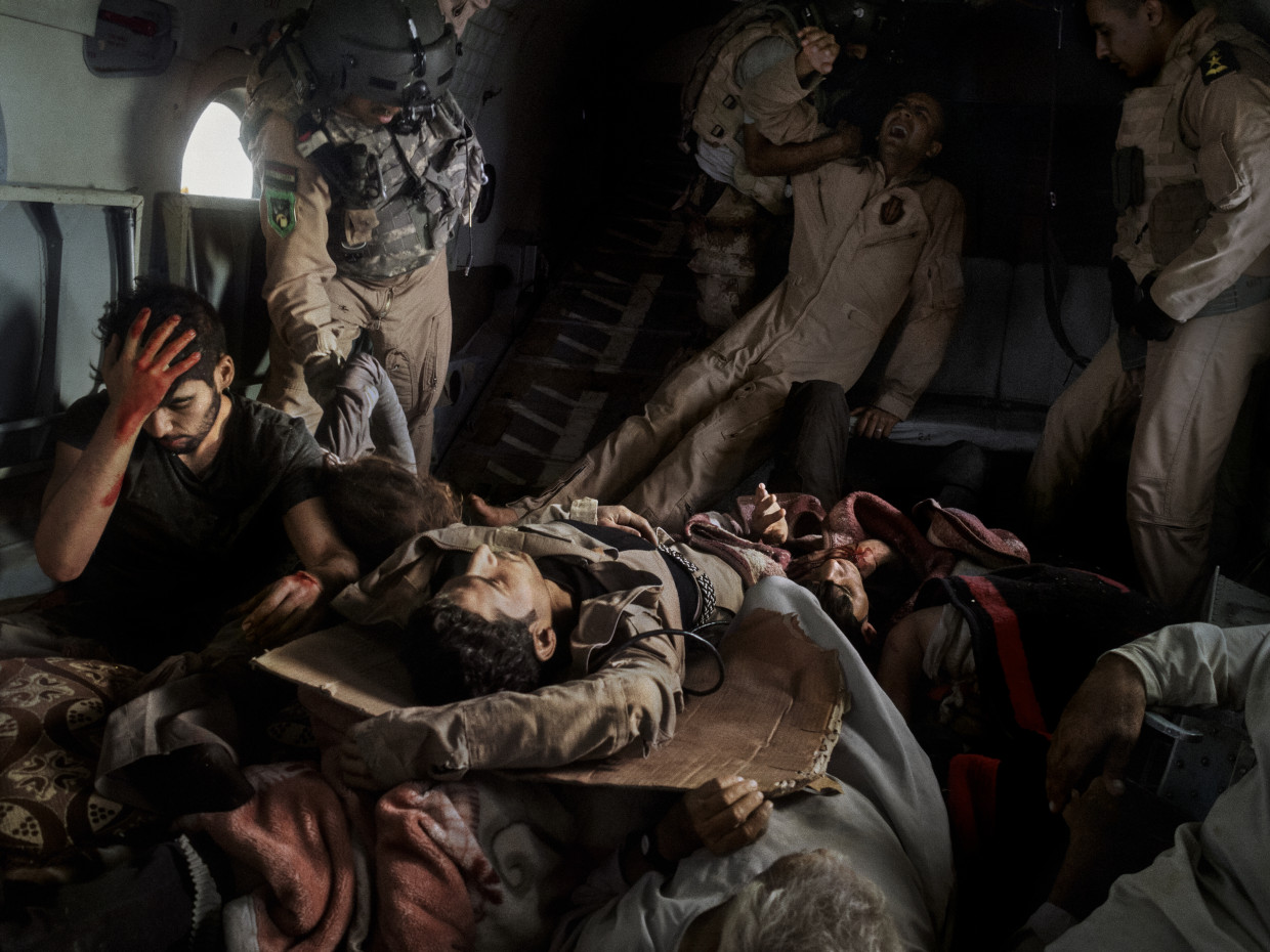 Sinjar, Iraq. August, 2014. Injured survivors of a helicopter crash in Mount Sinjar are evacuated to safety in an Iraqi Air Force rescue helicopter.