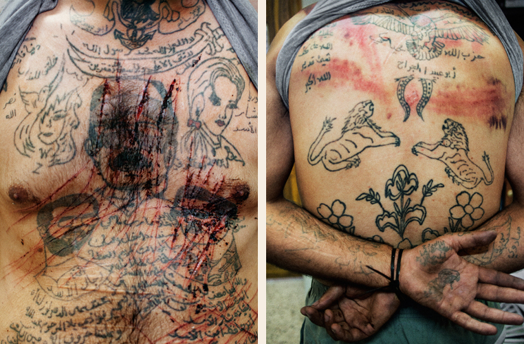 Marae, Syria. July, 2012. The torso and back of Zakariyya Gazmouz, a suspected Shabiha prisoner, his body covered in pro-Assad tattoos that he later defaced with a razor.