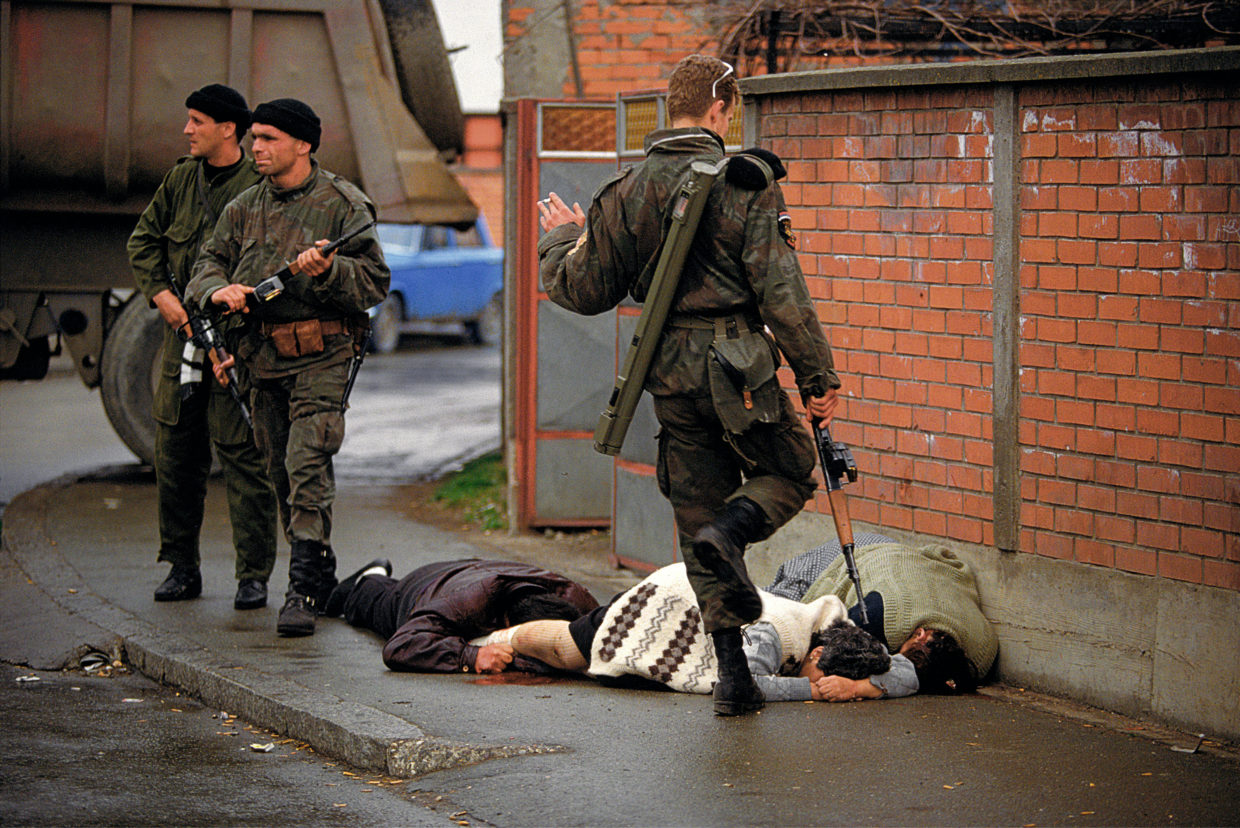 Arkan's Tigers kill and kick Bosnian Muslim civilians during the first battle for Bosnia in Bijeljina, Bosnia, March 31, 1992. The Serbian paramilitary unit was responsible for killing thousands of people during the Bosnian war, and Arkan was later indicted for war crimes.