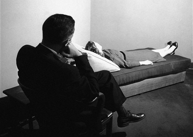 A psychoanalyst listens to a patient digging into her past at the New York Psychoanalytic Institute Treatment Center in New York City, 1956. Courtesy of Redstone Press.