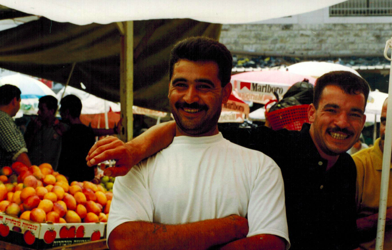 Men at the Market in Ramallah, Palestine, Circa 1998-99 (Photo by Chivvis Moore)