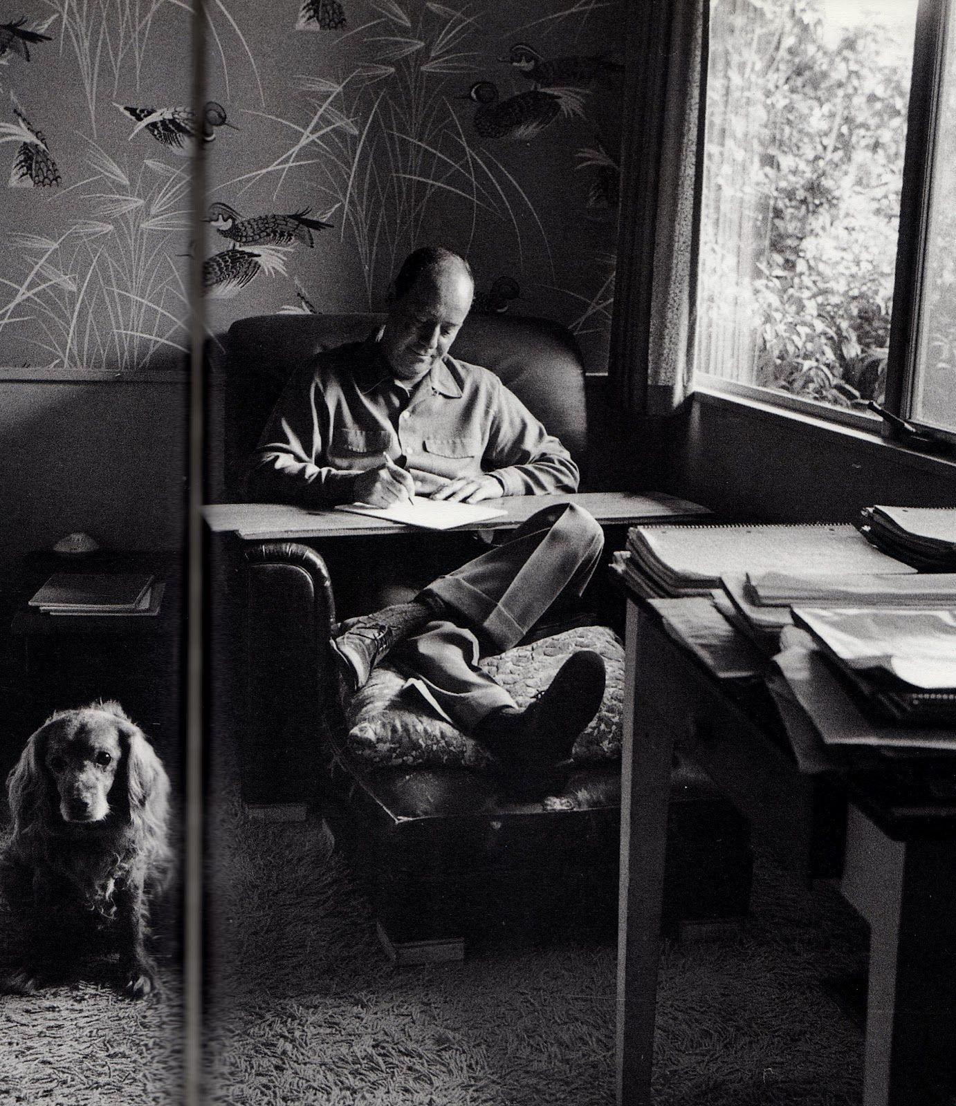 Ross MacDonald, writing with dog