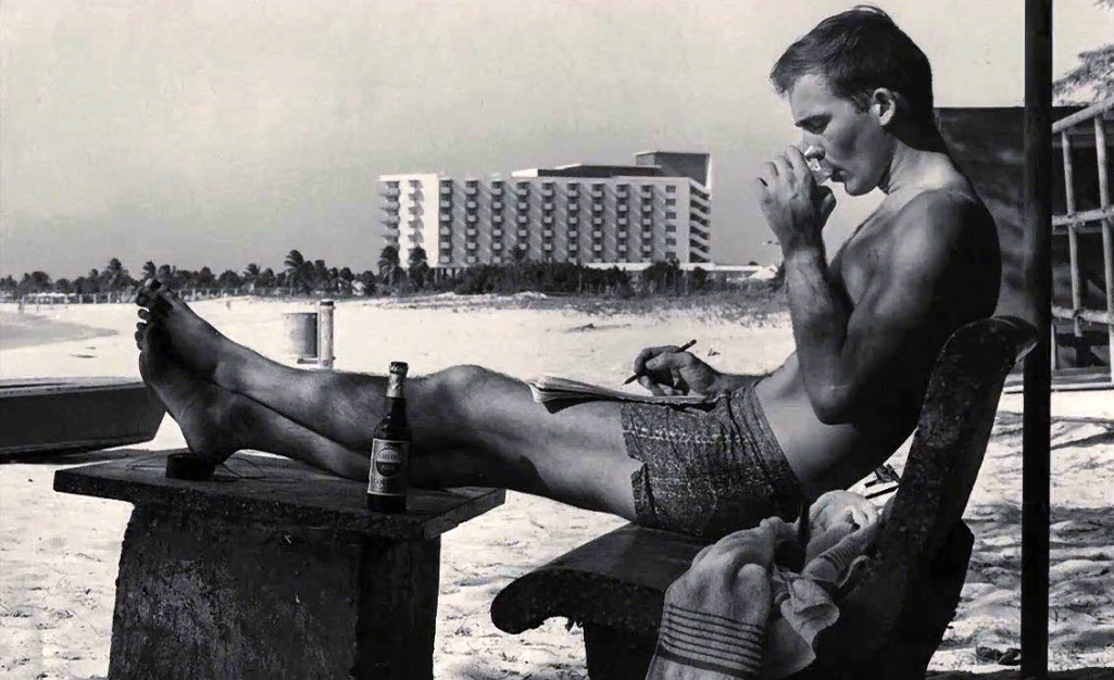 Hunter S. Thompson, writing on the beach