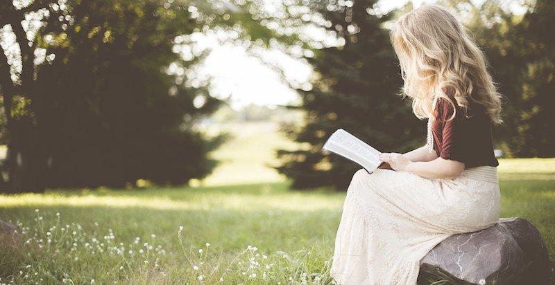 blond woman reading